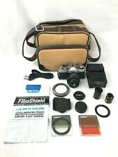 Minolta XG-1 35mm Film Camera w/Extra Lens Parts, Flash, Film, and Bag
