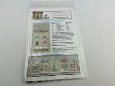 country cottage needleworks Skating Couple Cross Stitch Pattern Winter Wonderlan