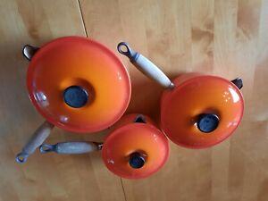 Le Creuset Volcanic Orange 3 Pan set with lids. 16 cm, 18 cm and 20 cm.