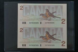 Canada 1986 $2 EGT prefix un-cut pair ch-UNC condition Thinness Crow Sign (d029)