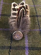 Scottish pheasant feather Brooch, Pin, Plume with a spent 12 Bore Headstamp.