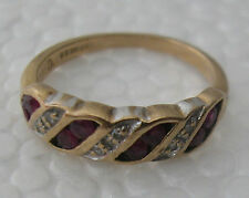 A GORGEOUS 9 K YELLOW AND WHITE GOLD SMALL RING SET WITH 8 RUBIES AND 6 OTHER