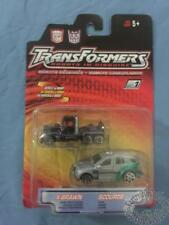 TRANSFORMERS X-BRAWN AND SCOURAGE ROBOTS IN DIGUISE 2 PACK