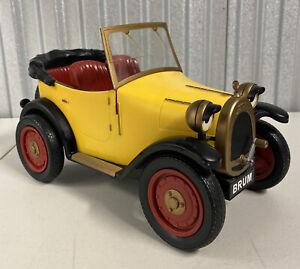 2003 BRUM R/C YELLOW CAR ROADSTER RAGDOLL REMOTE CONTROLLED RADIO SHACK Vintage