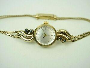 Schöne alte Quinn Condor Damen Armbanduhr mit Saphiren, 835er Silber vergoldet.