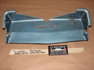 76 Cadillac Sedan DeVille REAR BUMPER LICENSE PLATE CENTER FILLER PANEL #1603560