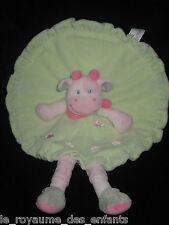 Doudou plat rond Vache avec jambes rose & vert Nicotoy fleurs papillon brodés