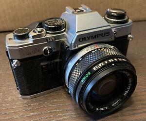 Olympus OM10 camera w/Olympus 50mm f1.8 lens       (bx 110)