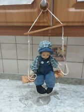 VINTAGE MARIONETTE PUPPET SITTING ON A SWING, PORCELAIN FACE.