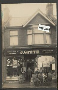 Postcard Bournemouth Dorset shop front J White of Winton bicycle record early RP