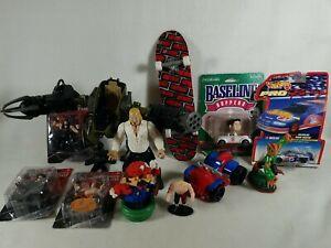 Lot Of 12 Mixed Boys Toys WWE Mecha Skateboard Mario Nascar