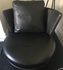Excellent condition black leather KING Swivel Leather Chair. Small kink at back.