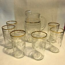 Beautiful vintage milk/juice Pitcher Set & 6 matching glasses with etched design
