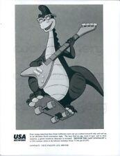 Press Photo Denver The Last Dinosaur on Skateboard Playing Guitar TV