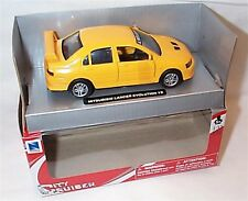Mitsubishi Lancer Evo7 jaune échelle 1-32 NEW IN BOX