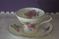 AYNSLEY PALE YELLOW CORSET SHAPED TEA CUP AND SAUCER WITH FLORAL BOUQUET