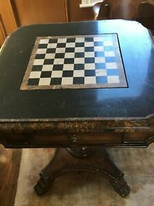 Game table/ side tableMarble chess/checker top, mahogany wood with gold leaf.