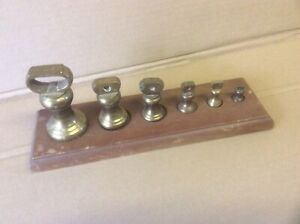Set of brass weights on board