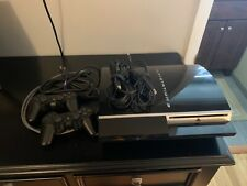 Sony PS3 fat original console and controles. Includes 10 games.