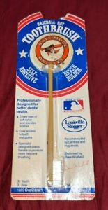 BALTIMORE ORIOLES 1986 BASEBALL BAT MLB ORACARE COLLECTIBLE TOOTHBRUSH & HOLDER