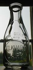 ELKHART DAIRY ROUND EMBOSSED QT IN ELKHART INDIANA IND IN MILK BOTTLE