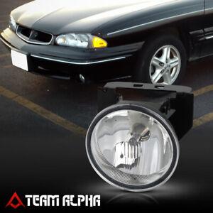 Fits 1992-1999 Pontiac Bonneville [LH/RH] Clear OE Replacement Bumper Fog Light