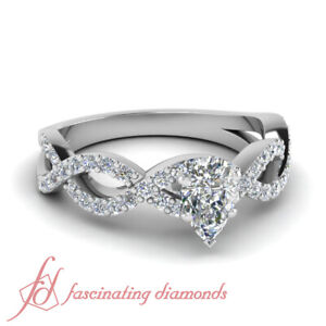 One Carat Pear Diamond Infinity Engagement Rings In Platinum With Round Accents