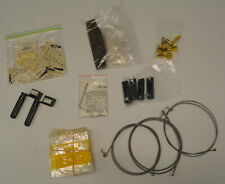 LOT OF MISC GUITAR PARTS/SUPPLIES - STRINGS, BRIDGE PARTS, WINDING WRENCH ETC.