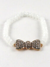 Gold Toned Clear Rhinestone Bow Stretch Bracelet With White Crystal Beads