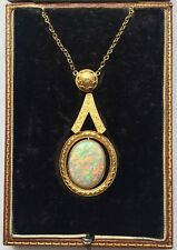 A Magnificent 20ct Fiery Opal & Filigree Gold Pendant Circa 1800's