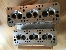 NOS OEM GM PAIR ALUMINUM 3.1L CHEVY CYLINDER HEADS  10048651