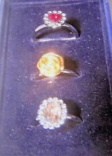 LOVELY SET OF THREE RHODIUM RINGS, HEART, FLOWER AND OVAL WITH CRYSTALS SIZE 8