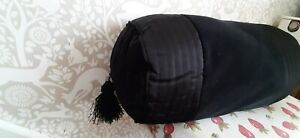 Dorma black fringed bolster cushion
