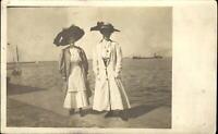 RPPC Edwardian fashion huge hats~ women on pier~ freighter sailboat~ 1904-1918