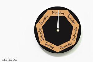 DayClocks - Heptagon Black & Orange Wall Clock - Day of The Week Clock