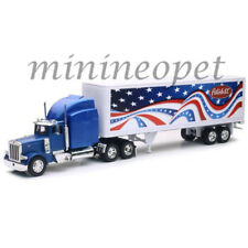 NEW RAY SS-12333 LONG HAUL TRUCKER PETERBILT MODEL 379 PATRIOTIC TRUCK 1/32 BLUE