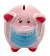 Sparschwein rosa mit Maske Mundschutz Mundnasenbdeckung  11cm