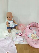 Baby born doll with accessories.