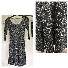 BLACK FLORAL PRINT SKATER DRESS..SIZE 8