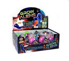 Crecer un extraterrestre en lugar de incubación de huevos en agua y Reloj escotilla Niños Diversión Navidad Juguete