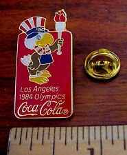 1984 LOS ANGELES OLYMPICS COCA COLA SAM THE EAGLE MASCOT & TORCH LICENSED PIN