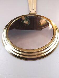 Hanging round brass mirror with leather strap hanger 8 inches around no brand