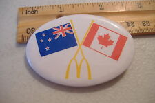 ~MCDONALDS~NEW ZEALAND & CANADA FLAGS~OVAL BUTTON PIN~