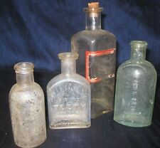 Lot of 4 Antique Bottles Mexican Mustang Liniment, Rubifoam Teeth, Ponds, L Bros