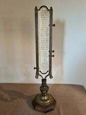 Ancien calendrier en bronze sur pied avec bougeoir 61 cm de hauteur