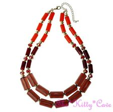 Quality Bright Orange, Red & Smokey Brown Tube Beads Matte Gold Catwalk Necklace