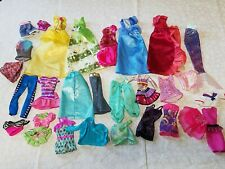 Lot #2- 28 pc. Of Barbie plus other brands Clothing Dresses Skirts pants shirts