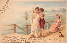 Vintage postcard women one piece bathing suits sailboat boat sand ocean