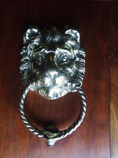 Ancien heurtoir de porte en laiton  poli   , tète de lion