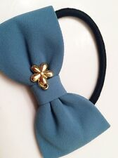 Blue Bowknot Hair String with an Elegant Daisy Flower